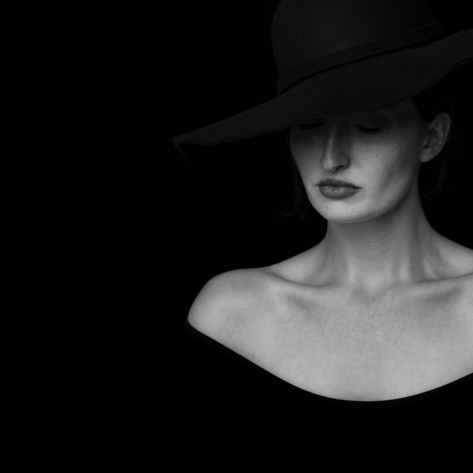 Woman with hat on thinking